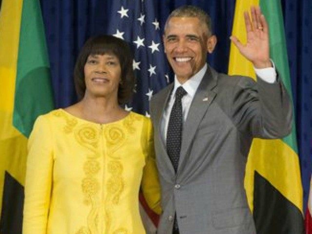 President Barack Obama poses with Jamaican Prime Minister Portia Simpson Miller prior to their bilateral meeting at the Jamaica House, Thursday, April 9, 2015 in Kingston, Jamaica.