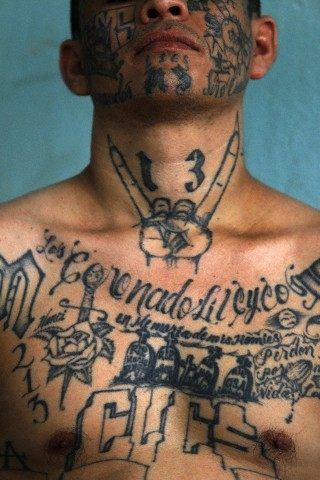 El Recio, a former leader of the Mara Salvatrucha or M -13 gang, poses during a photo session at Comayagua jail in Honduras