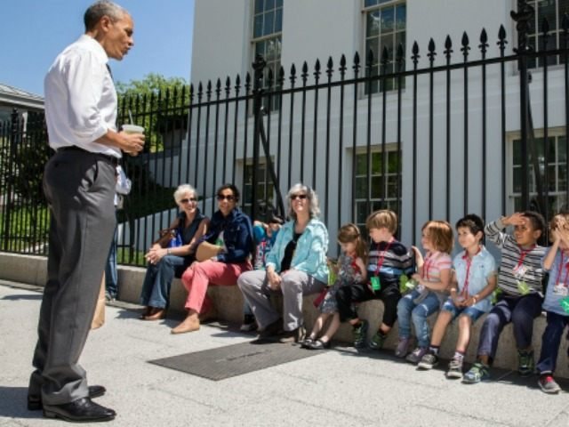 President Barack Obama stops to talk with visiting school children outside the West Wing of the White House, April 29, 2015. The President was returning from a walk with Shanna Peeples, the 2015 National Teacher of the Year, when he met the children and their chaperones.