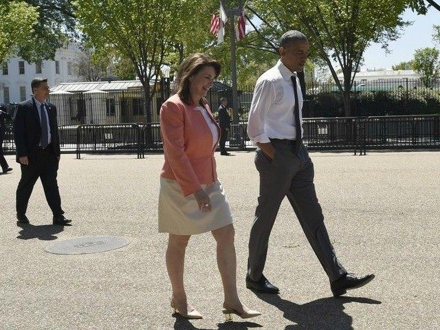 President Barack Obama takes a walk along Pennsylvania Avenue in Washington, Wednesday, April 29, 2015, with 2015 National Teacher of the Year Shanna Peeples of Amarillo, Texas, following an event to honor the 2015 National Teacher of the Year and finalists in the Rose Garden.
