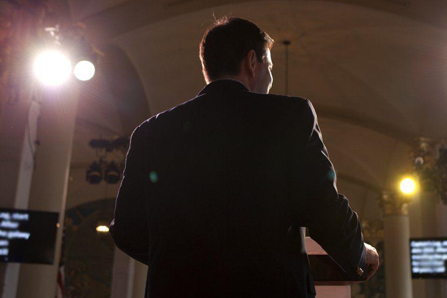 Rubio walk through podium