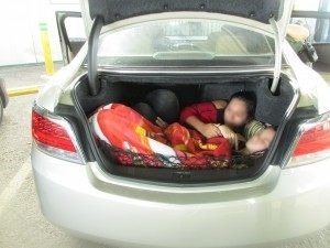 Two illegal immigrants stuffed in the trunk of a car