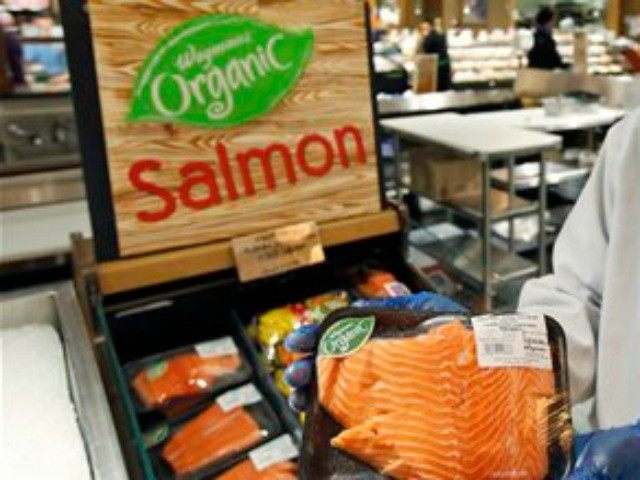 Chef Charles Hill poses for a picture as he holds a Canadian certified organic farm-raised King Salmon at the Wegmans, Friday, April 10, 2015 in Fairfax, Va. Organic fish is certified in the EU and Canada because the US doesn't have any standard. After more than a decade of delays, …