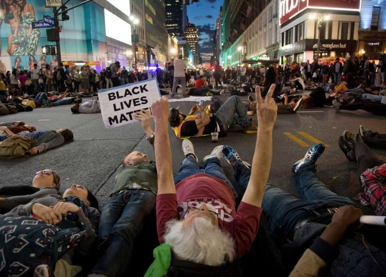 Protesters lay in the street to stage a die-in at Herald Square, Wednesday, April 29, 2015, in New York. Several hundred people gathered in New York on Wednesday to protest the death of Freddie Gray, a Baltimore man who was critically injured in police custody, and more than a dozen were arrested. (AP Photo/Julie Jacobson)
