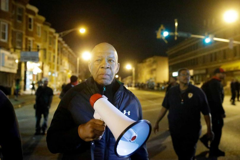 U.S. Rep. Elijah Cummings, D-Md., encourages protesters to comply with the 10 p.m. curfew Wednesday, April 29, 2015, in Baltimore. The curfew was imposed after unrest in Baltimore over the death of Freddie Gray while in police custody.  (AP Photo/Matt Rourke)