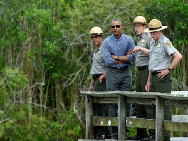 "President Barack Obama walks the Anhinga Trail at Everglades National Park, Fla,, Wednesday, April 22, 2015. Obama visited the Everglades on Earth Day to talk about how global warming threatens the U.S. economy. He says rising sea levels are putting the ""economic engine for the South Florida tourism industry"" at …"