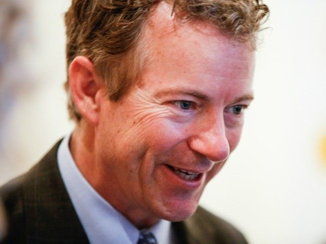 Sen. Rand Paul (R-Ky.) smiles as he arrives for a private reception for Britain's Prince Charles at the British Ambassador's Residence on Wednesday, March 18, 2015 in Washington. (AP Photo/Andrew Harnik)