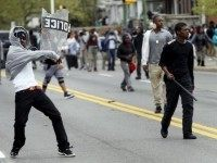 Demonstrators throw rocks at Baltimore police during clashes in Baltimore