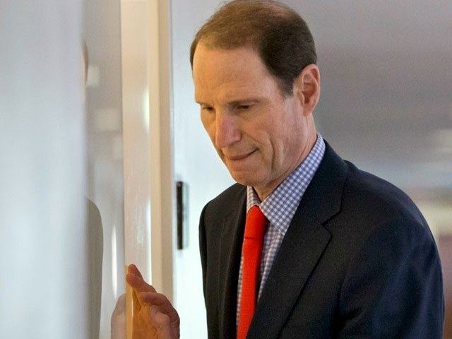 Senate Intelligence Committee member Sen. Ron Wyden, D-Ore. arrives for a closed-door briefing with national security officials on the situation in Syria, Thursday, Sept. 5, 2013, on Capitol Hill in Washington. President Barack Obama has requested congressional authorization of military intervention in Syria in response to last month's alleged sarin …