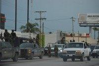 Mexican soldiers guard the Federal Police building in Matamoros following a grenade attack.