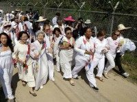 U.S. activist Gloria Steinem, seventh from right, two Nobel Peace Prize laureates Mairead Maguire, from Northern Ireland, third from right, Leymah Gbowee, from Liberia, fourth from right, and other activists march to the Imjingak Pavilion with South Korea.