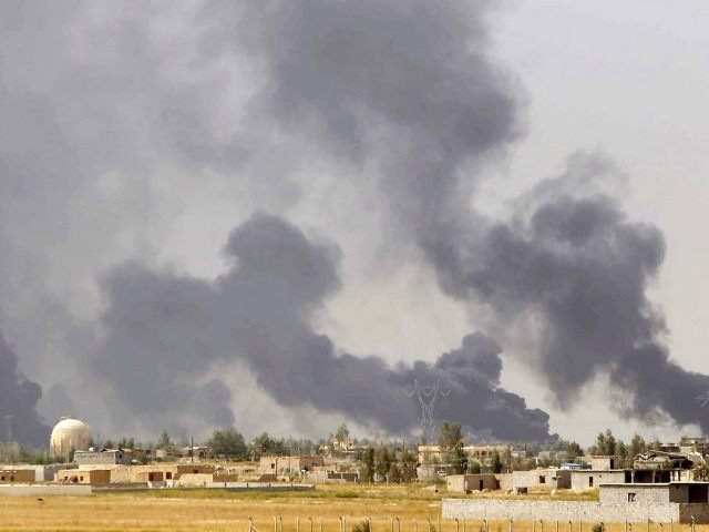 smoke rising above the Baiji area as Iraqi