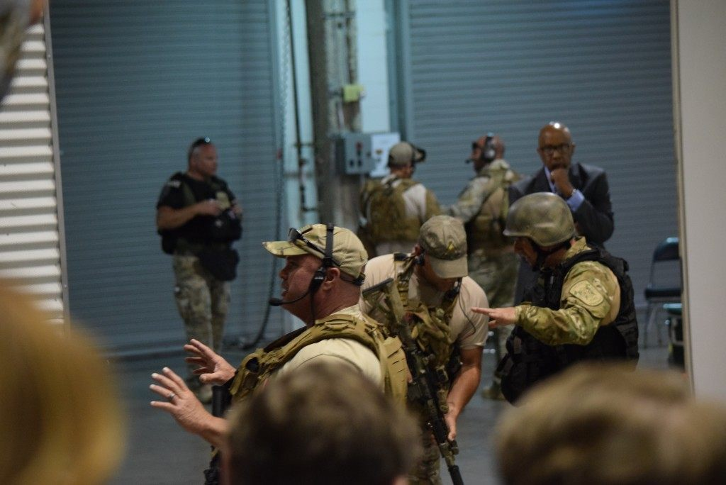 Garland Police SWAT Officers brief attendees on what is happening. Breitbart Texas photo by Lana Shadwick.
