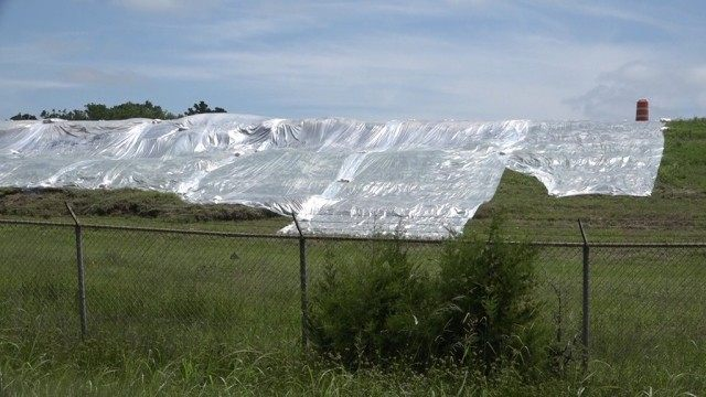 Protective tarps laid down by Entegy work crews to prevent further soil saturation and mud slides. Photo Courtesy of the Montgomery County Police Reporter