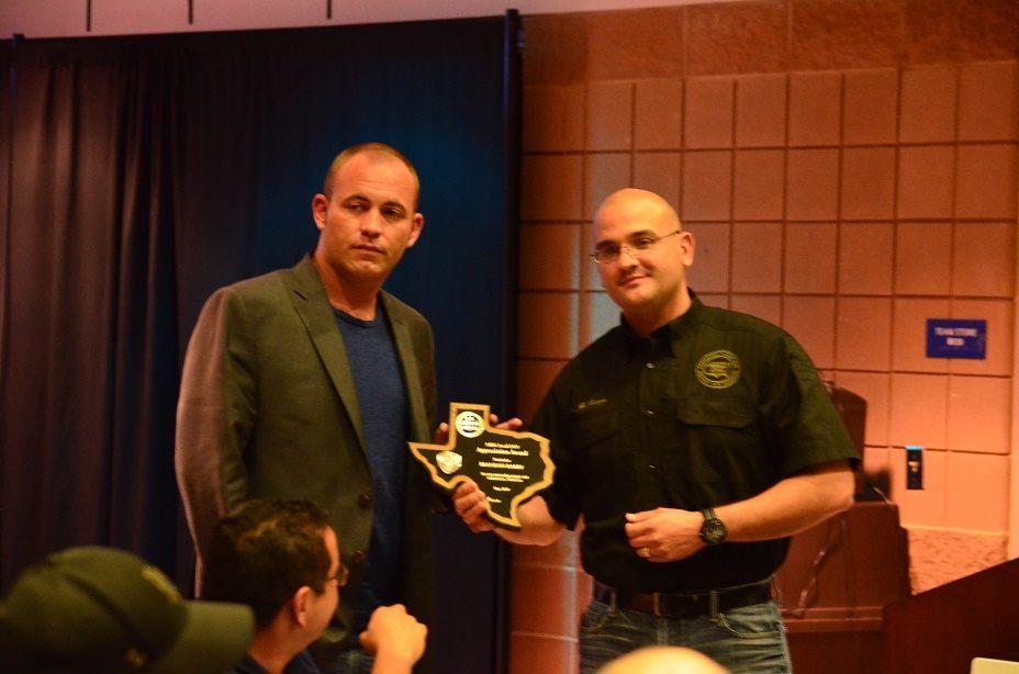 Brandon Darby accepts an appreciation award from
