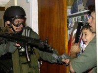The international fight over where Gonzalez would live ended with him returning to Cuba. In this picture, armed federal agents seized Elian Gonzalez from the home of his Miami relatives before dawn, firing tear gas into an angry crowd as they left the scene with the weeping 6-year-old boy.