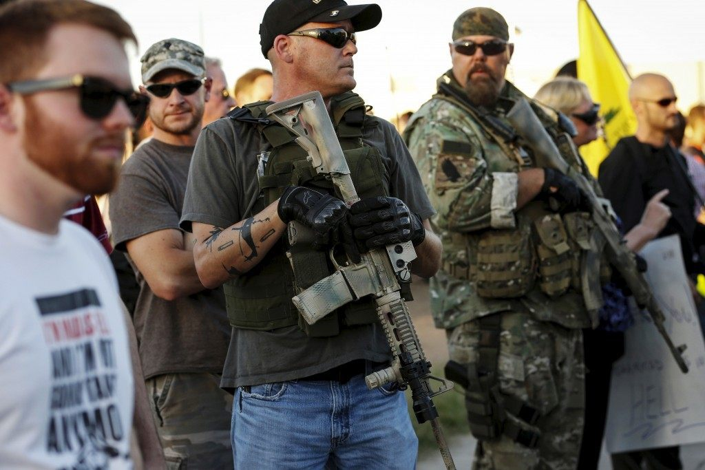 """Men carrying rifles attend """"Freedom of Speech Rally Round II"""" across from Islamic Community Center in Phoenix"""