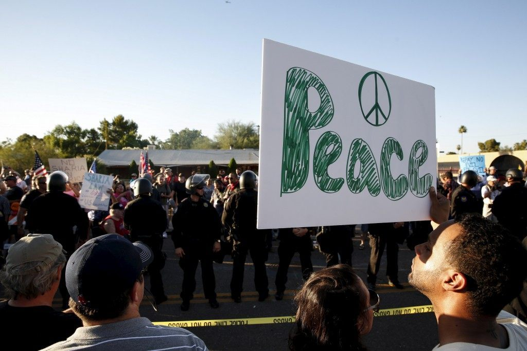 """Counter demonstrators look over to those attending """"Freedom of Speech Rally Round II"""" outside Islamic Community Center in Phoenix"""