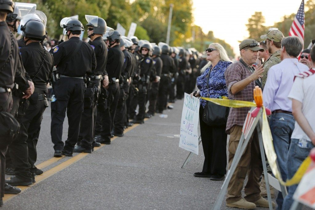 """Police line separates people attending """"Freedom of Speech Rally Round II"""" from counter demonstrators outside Islamic Community Center in Phoenix"""