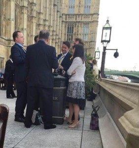 Near the trash: Alex Salmong uses bin as table on Commons Terrace.