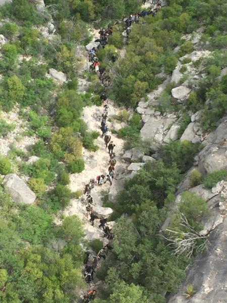 Aerial view of 73 illegal immigrants moving through a Texas ranch