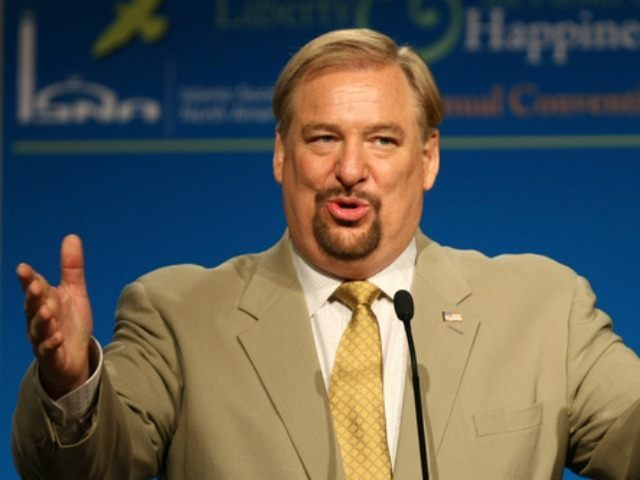 In this Saturday, July 4, 2009 file photo, evangelical pastor Rick Warren gestures as he speaks at the Islamic Society of North America's 46th annual convention in Washington. The American evangelical pastor Rick Warren, who addressed a big rally in the Rwandan capital of Kigali on Sunday, Aug. 17, 2014, …