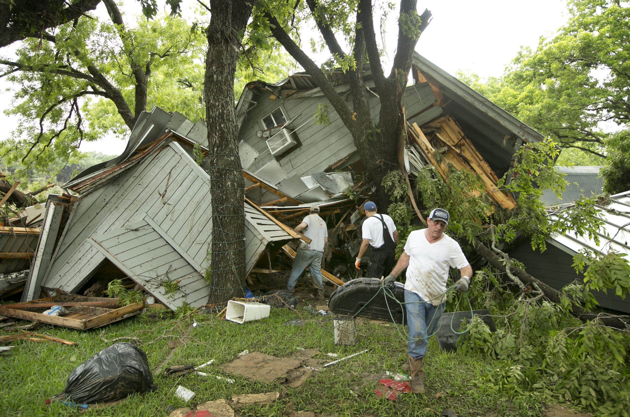 ... from Mother's Arms in Mexican Border City, Texas Ravaged by Storms