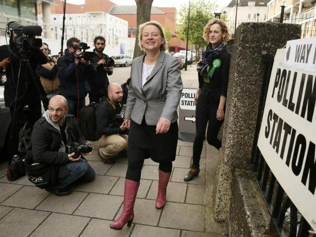 Natalie Bennett (C), the leader of the Green Party leaves after voting at a polling station in London (REUTERS/Phil Noble)