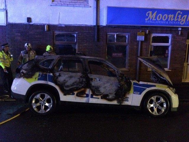 burnt police car