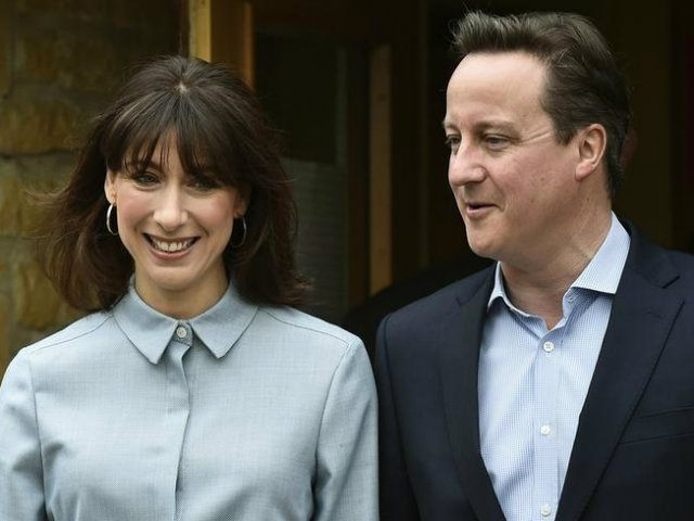 Britain's Prime Minister David Cameron and his wife Samantha leave after voting in Spelsbury (REUTERS/Toby Melville)