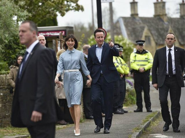 Britain's Prime Minister David Cameron arrives with his wife Samantha to vote in Spelsbury (REUTERS/Toby Melville)