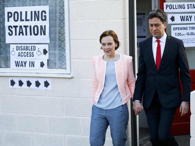 Britain's opposition Labour Party leader Ed Miliband leaves after voting with his wife Justine in Doncaster (REUTERS/Darren Staples)