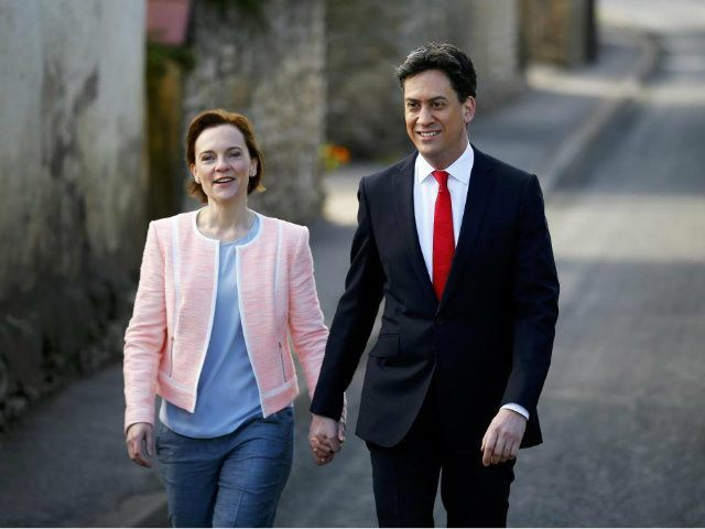 Britain's opposition Labour Party leader Ed Miliband arrives to vote with his wife Justine in Doncaster (REUTERS/Darren Staples)