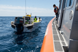 Coast Guardsmen from Station South Padre Island, Texas, catch and detain Mexican nationals aboard a lancha after crews in Coast Guard aircraft spotted them fishing illegally in U.S. territorial waters Friday, May 1, 2015. U.S. Coast Guard photo