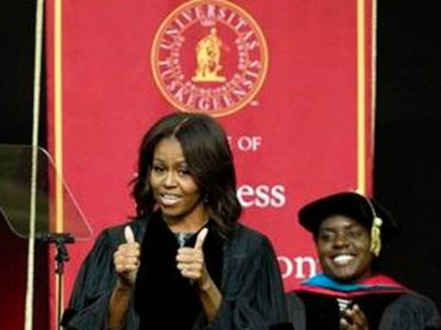 First Lady Michelle Obama gives thumbs up after walking on stage at Tuskegee University, Saturday, May 9, 2015.