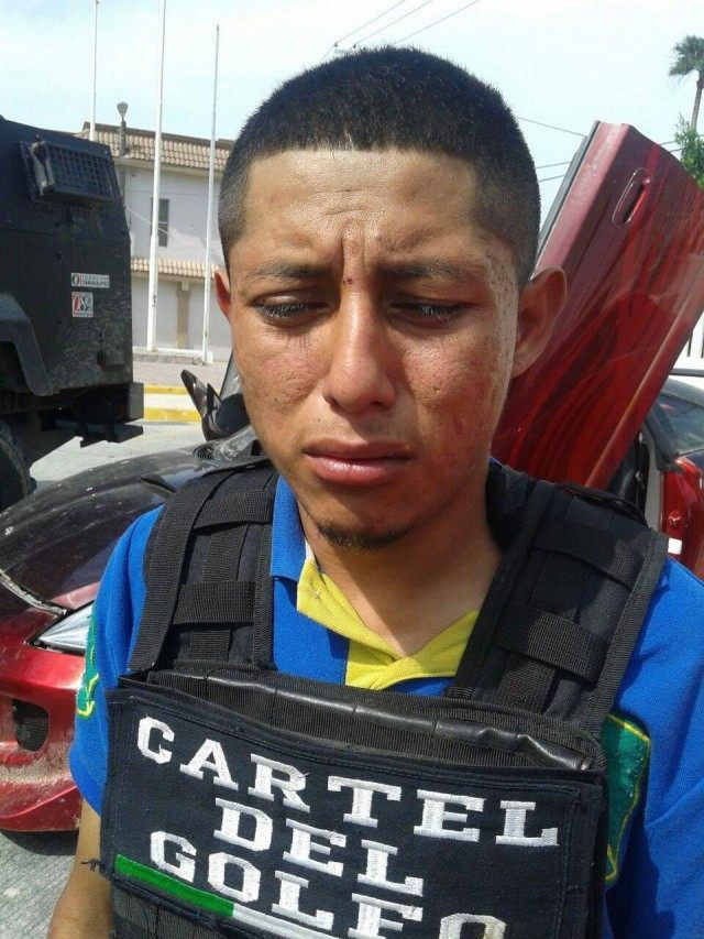 Gulf Cartel suspected gunman who appears to cry following his arrest