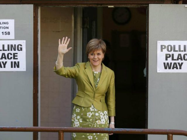Nicola Sturgeon, the leader of the Scottish National Party, waves after voting in Broomhouse, Scotland (REUTERS/Russell Cheyne)