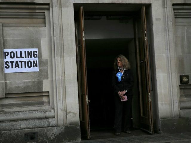 A Conservative supporter waits at a polling station in central London. (REUTERS/Stefan Wermuth)