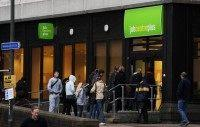 People enter a job centre in Bromley, Ke