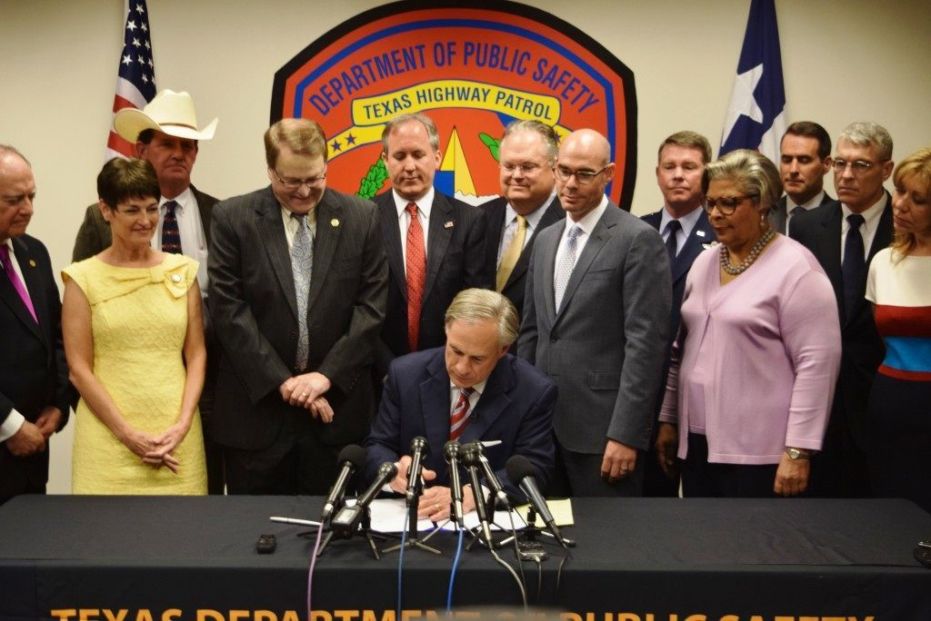 Texas Governor Greg Abbott signs Texas border security bills into law. (Photo: Breitbart Texas/Lana Shadwick)