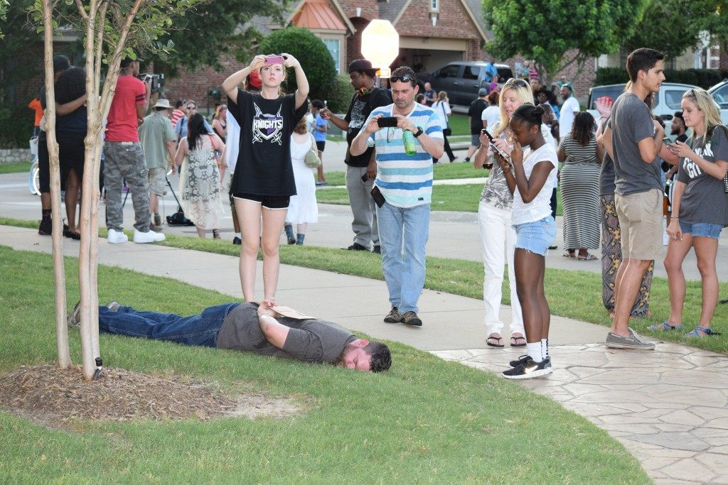 "Craig Ranch resident lies in ""arrest pose"" on the spot where teenage girl was forced to the ground. (Photo: Breitbart Texas/Bob Price)"