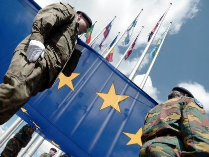 Soldiers of a Eurocorps detachment raise the European Union flag to mark the inaugural European Parliament session on June 30, 2014, in front of the European Parliament in Strasbourg, eastern France.