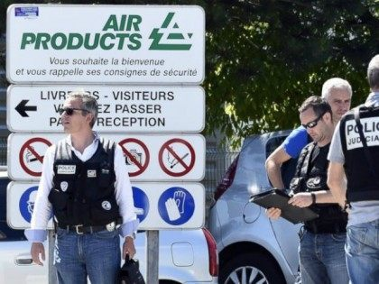 PHOTO: French police secure the entrance of the Air Products company in Saint-Quentin-Fallavier, near Lyon, central eastern France, on June 26, 2015. French police secure the entrance of the Air Products company in Saint-Quentin-Fallavier, near Lyon, central eastern France, on June 26, 2015.