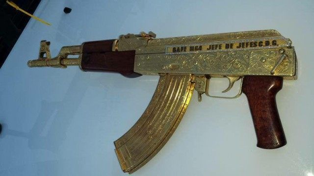Gold plated AK-47 with an inscription identifying it as belonging to Gulf Cartel Commander El Gafe