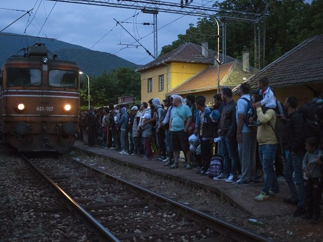 migrants try to board a Hungarian train