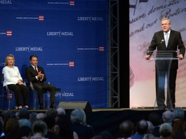 Former Secretary of State Hillary Rodham Clinton and Jeffrey Rosen, president and CEO of the National Constitution Center, listen as former Florida Gov. Jeb Bush speaks before the presentation of the 2013 Liberty Medal September 10, 2013 in Philadelphia, Pennsylvania. The Liberty Medal was established in 1988 to commemorate the …