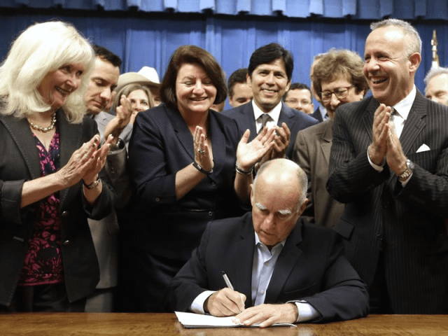 Jerry Brown signs (Rich Pedroncelli / Associated Press)