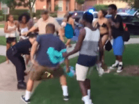 Two young men charge police officer as he attempts to detain teenage girl. (Photo: YouTube/Brandon Brooks)