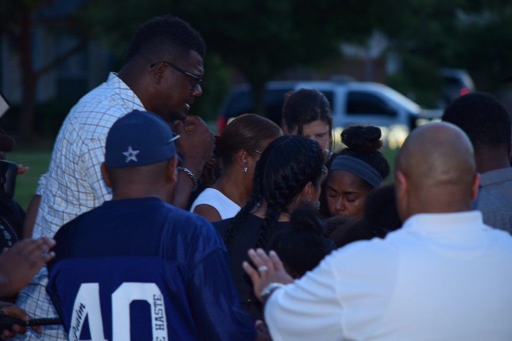 McKinney police keep maintain a protective watch while pastors provide healing prayer for Craig Ranch residents. (Photo: Breitbart Texas/Bob Price)