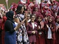 U.S. first lady Michelle Obama is greeted by pupils as she arrives at Mulberry School for Girls in east London, Tuesday, June 16, 2015. Michelle Obama is due to meet with female students in London on Tuesday to encourage them to pursue top educational goals.